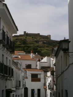 White streets of Aracena and its castel on top of the hill